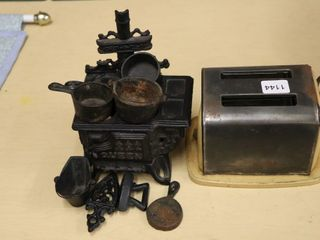 TOY TOASTER AND CAST WOOD STOVE