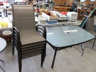 GlASS TOP PATIO TABlE AND 6 CHAIRS 38 X60 X29