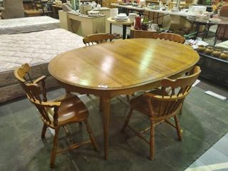 Wooden Table w   3  leaf Inserts and  4  Matching Chairs  Davis Cabinet Co