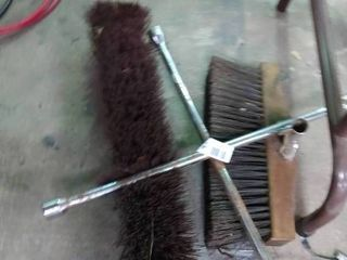4 way lug wrench and 2 broom heads