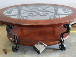 Signature Design by Ashley   Nestor Traditional Glass Top Oval Coffee Table w  Fixed Shelf   Medium Brown    Some Damage  See Photos