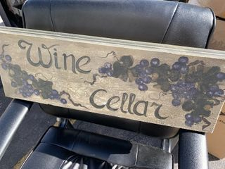 Wine seller sign made from repurposed wood