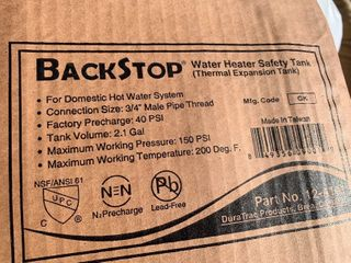 Water heater backstop tank