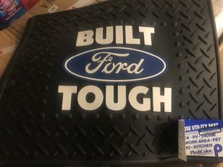 Two new Ford floor mats has pictures