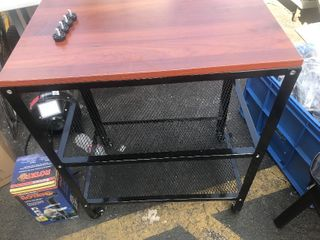 Nice rollaround storage metal table as pictured new