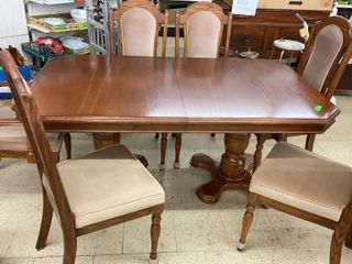 Beautiful oak table with six matching chairs.