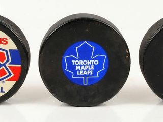 3 Hockey Pucks with Maple leafs   Canadians