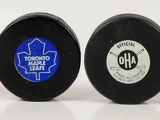 Hockey Pucks with NHl   Maple leafs