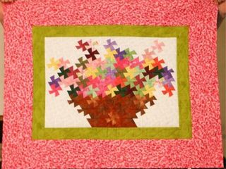 Pinwheel Twist Flower Basket  hand quilted