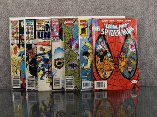 lot of 7 Marvel Comics  Amazing Spider Man  1998 2nd Series   5  Silver Surfer  1987 2nd Series  Annual  3  Marvel Saga  1985   7   12 and More