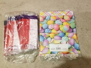PACKAGE OF EASTER GIFT BAGS AND BAG OF TISSUE PAPER
