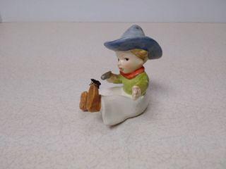 Cowboy boy figurine with spider on shoe