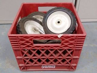 crate filled with white metal rim tires