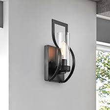 Anastasia 1 light Wall Sconce with Clear Glass Shade and Curved Frame black