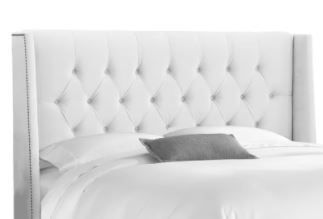 Skyline Furniture MFG  Velvet Tuffet Button Tucked Headboard