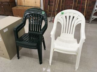 2 white, 2 green plastic stack chairs
