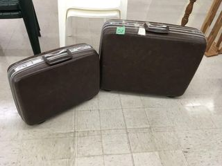 pair samonsite suitcases