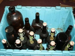 Brown Glass Bottles and Blue Plastic Tub
