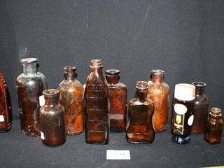 Various smaller brown Glass Bottles