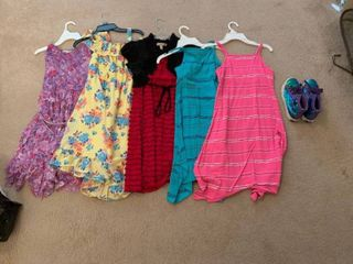 Girls dresses and a pair of tennis shoes