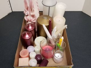 An assortment of candles and holders