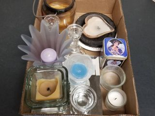 An assortment of candles and candleholders