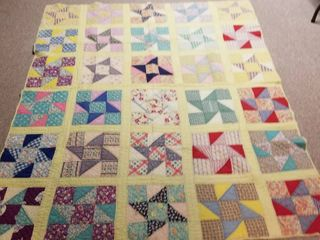 Yellow quilt approximately 6  by 5