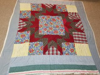 Quilt blue with red embellishment Approximately 6 x 6