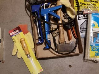 Caulking guns  axe  filters and gardening clippers