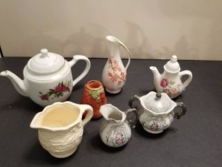 An assortment of vases  teapots and pitchers