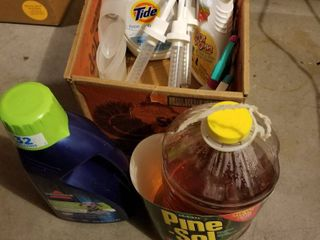 laundry supplies and large container of Pinesol