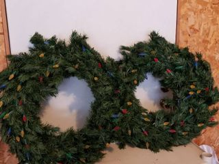 Holiday wreaths lighted