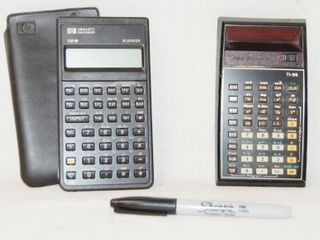 lot of 2 Calculators  One With A leather Case