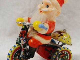 Vintage Santa Clause  Wind Up Bicycle  Toy