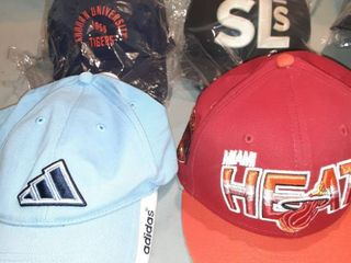 lot of 4 Baseball Caps  1 Velcro light Blue Adidas Hat  1 Snapback Red Miami Heat Hat  1 New in Package Adustable Back Auburn University  1 Fitted Back SlS Cap