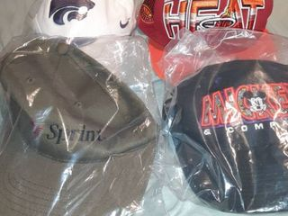 lot of 4 Baseball Caps  1 New in Package Sprint Adjustable Back  1 New in Package Mickey and Company Snapback  Miami Heat Snapback  1 New in Package Wildcats Fitted Cap