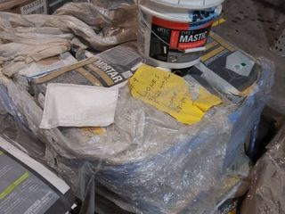 pallet of mortar grout underlayment and bucket of mastic