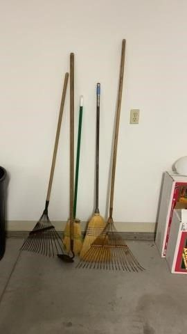 2 RAKES   A HOE AND 2 BROOMS