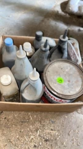 BOX OF OIlS AND GARAGE ITEMS