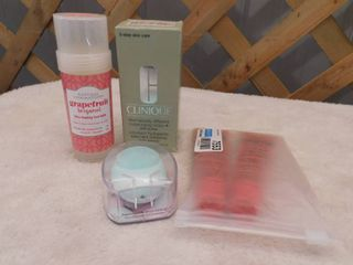 lot of Clinique dramatically different moisturizing lotion  2 lucas papaw remedies ointment  Natural inspirations grapefruit bergamot ultra healing foot balm  and a facial cleansing brush