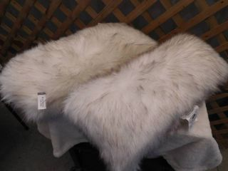 2 very fluffy Threshold toss pillows long 12inx24in  one has rip on seam  see pictures