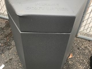 large gray commercial trashcan has pictures