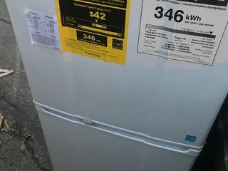 New apartment size refrigerator 4 foot tall larger freezer has shipping dents but everything still works plugged in works all the way