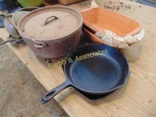 Cast iron ware including skillet and dutch oven