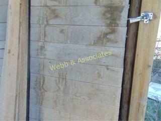 lots of barn wood  interior walls with doors and