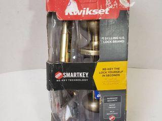 Kwikset Juno Entry Knob featuring SmartKey in Antique Brass