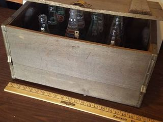 Wooden beer crate with soda bottles