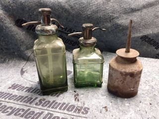 1 oil can and 2 liquid Soap dispensers