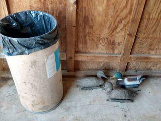barrel of duck decoys