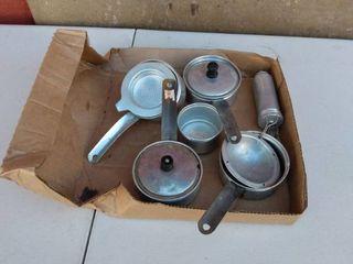 box of small aluminum pans